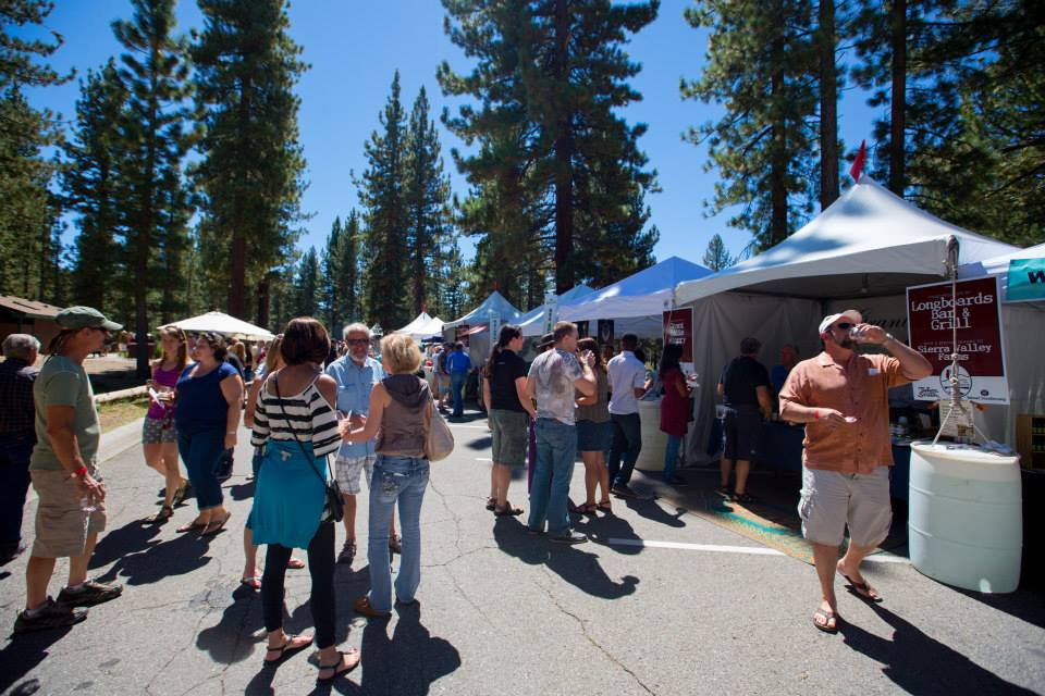 Festival goers enjoy the rows of vendors at Sample the Sierra